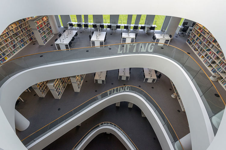 Central atrium of Sir Duncan Rice Building, Aberdeen University Library. Architecture Atrıum Books Curve Learning Lines Reading Architecture Building Interior Building Interior Detals Of Decor Built Structure Day High Angle View Indoors  Library Building Lines And Shapes Lines, Shapes And Curves