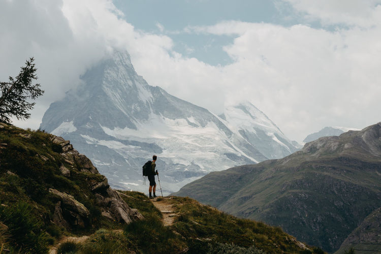 Man looking at view while standing on mountain
