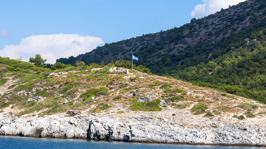 First Greek flag on the ferry ride from Kusadasi, Turkey, to Samos, Greece Aegean Sea Rocky Coastline Aegean Islands Beauty In Nature Flags In The Wind  Island Landscape No People Sky Water
