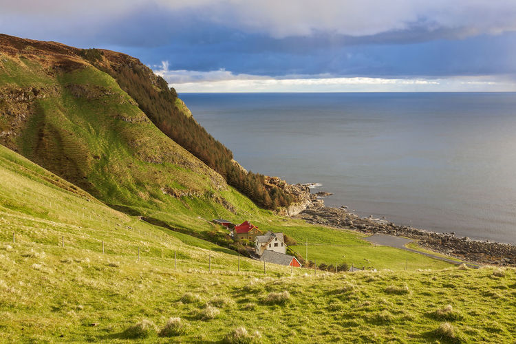 Rocky coastline and a farm at the sea in norway