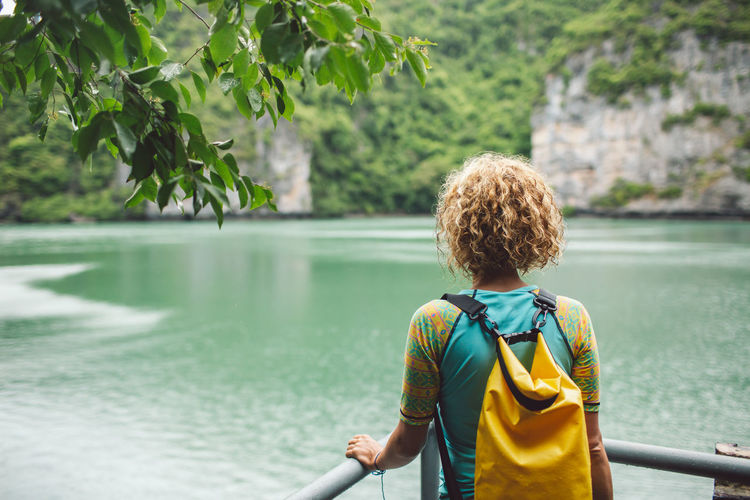 Curly Hair Girl Water Rear View One Person Real People Leisure Activity Nature Lifestyles Plant Day Casual Clothing Tree Hair Waist Up Beauty In Nature Focus On Foreground Lake Outdoors Hairstyle