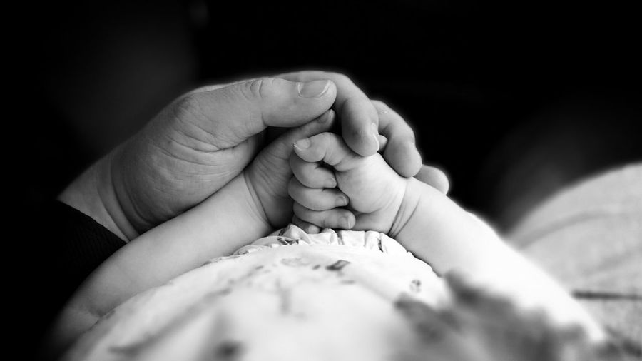 Close-up of hands of father and baby