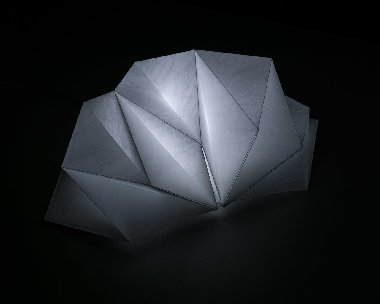 black background, studio shot, high angle view, paper, directly above, close-up, no people, illuminated, indoors, night