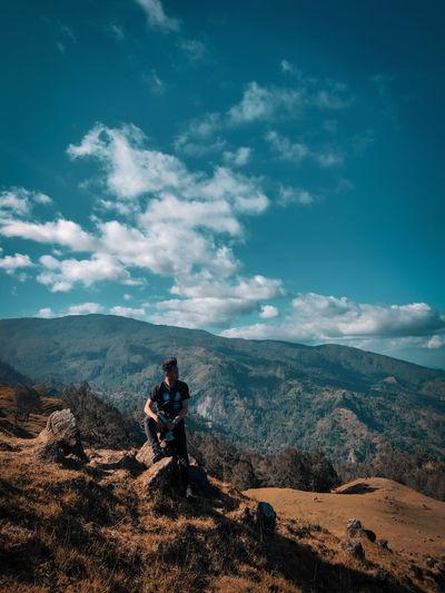 Man on mountain against sky