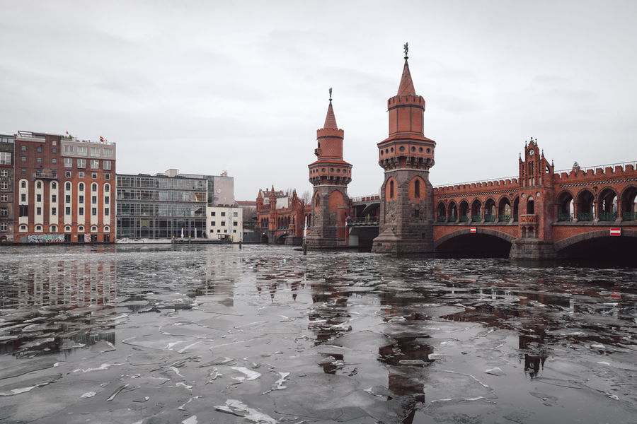 oberbaumbridge over spree river in Berlin city Berlin Berlin City Berlin Friedrichshain Cityscape Ice On The Water Oberbaumbrücke Sights & Views  Sightseeing Sightseeing Spot Winter Architecture Berlin Kreuzberg Berlinstagram Building Exterior Built Structure City Cityscape Cold Temperature Day Germany Nature No People Oberbaumbridge Outdoors Sky Snow Travel Destinations Urban Icon Water Waterfront Winter