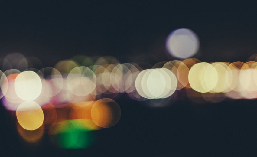 City Life Light Lights Backgrounds Circle City Lights Close-up Defocus Defocused Disco Lights Glowing Illuminated Lens Flare Light Effect Lighting Equipment Night No People Outdoors Pattern Projection Equipment Sky Vintage
