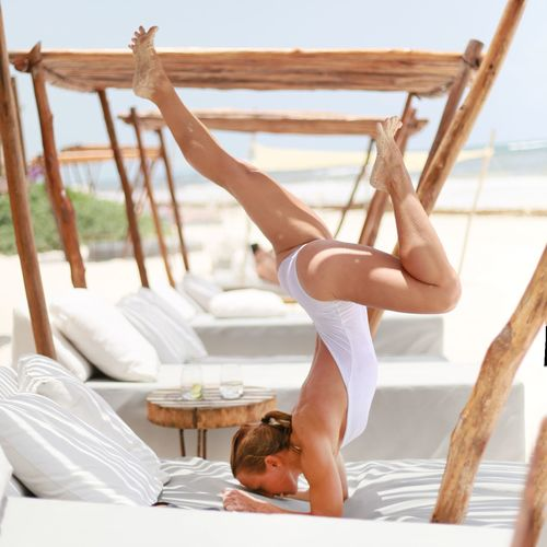 Woman In Bodysuit Practicing Yoga Outdoors