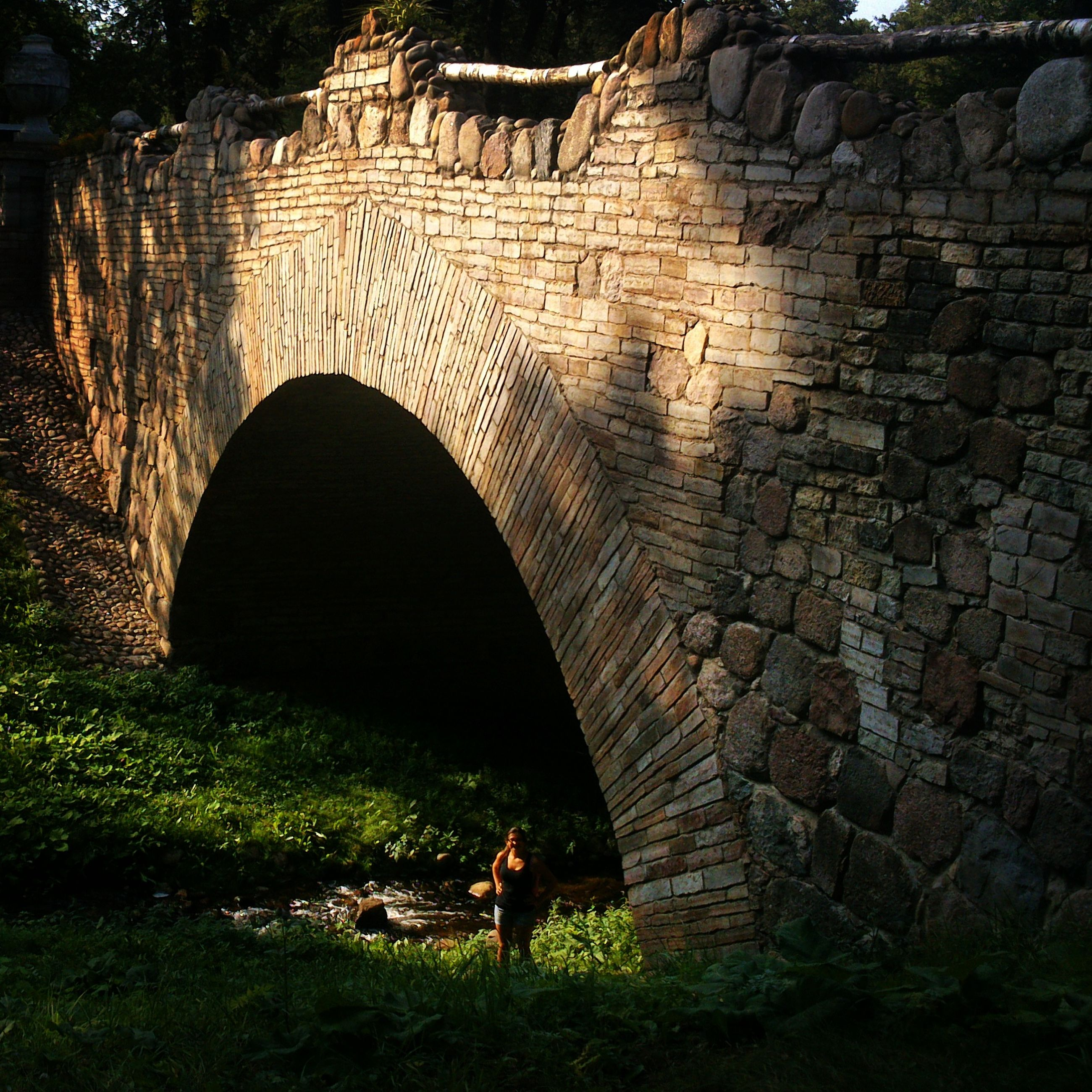 arch, architecture, built structure, history, stone wall, old ruin, men, ancient, standing, old, tunnel, building exterior, lifestyles, leisure activity, day, archway, travel destinations, wall - building feature