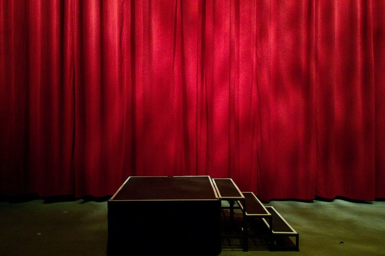 Red curtain hanging on stage