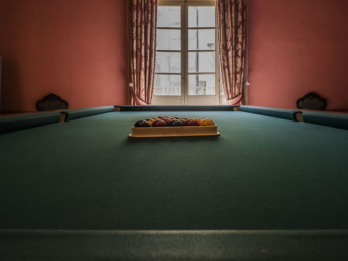 Pool balls on table at home