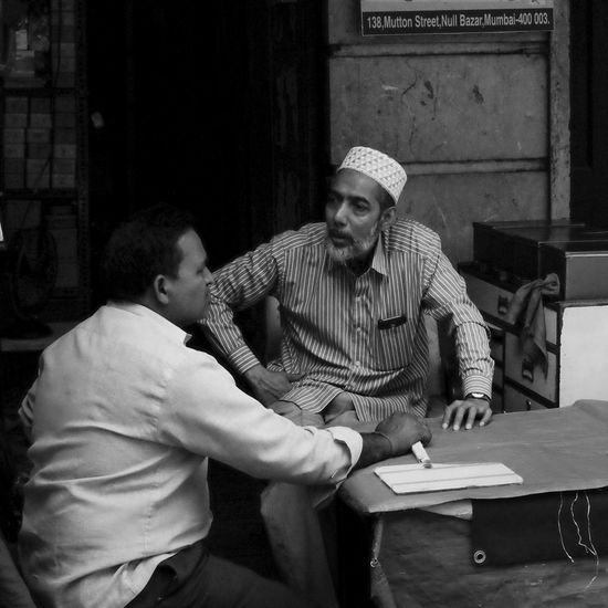 City Streetphotography India Street Photography Street People Adults Only Men City Street Mumbai Chor Bazaar Discussion Monochrome EyeEmNewHere