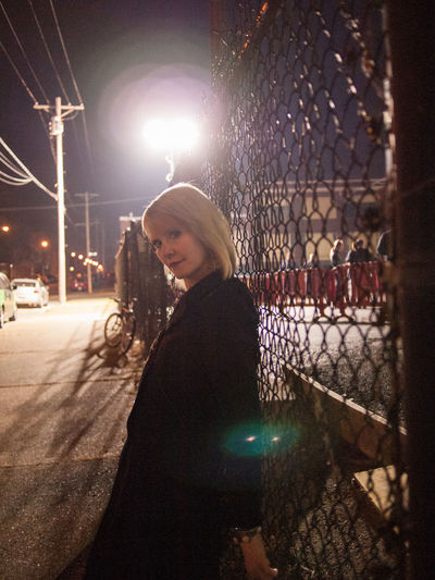 A Creature of the Night Architecture Beautiful Woman Blond Hair City City Lights At Night City Streets  Darkness Darkness And Light Femme Femme Fatale Lifestyles Mysterious Night Nightclub One Person One Woman Only Outdoors Portrait Real People Side View Smiling Standing Urban Geometry Winter Young Women