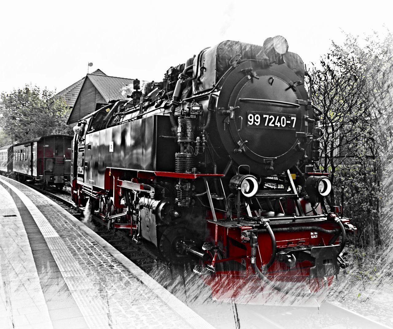 TRAIN IN RAILROAD TRACKS AGAINST SKY
