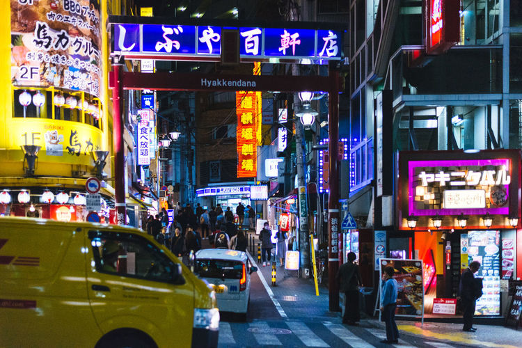 Near Shibuya Architecture Building Exterior Car City City Life Communication Crowd Illuminated Neon Night Outdoors People Road Street Text Travel Destinations