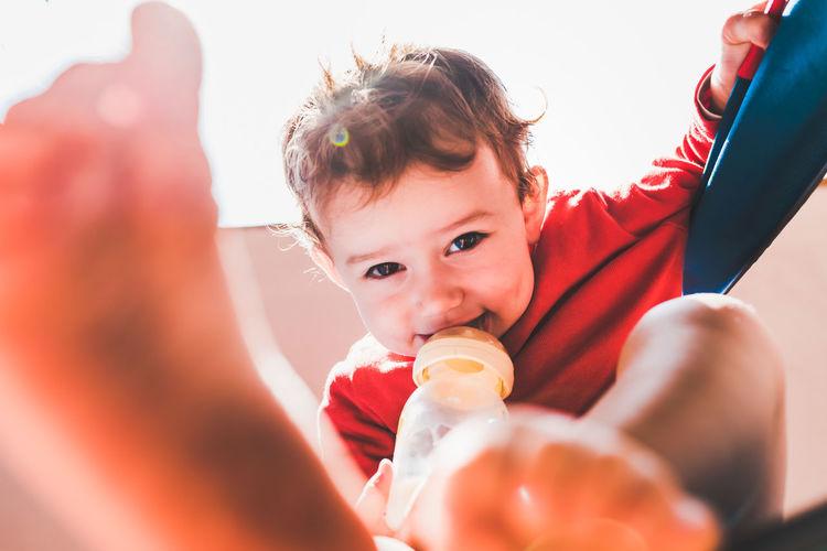 Boy holding bottle
