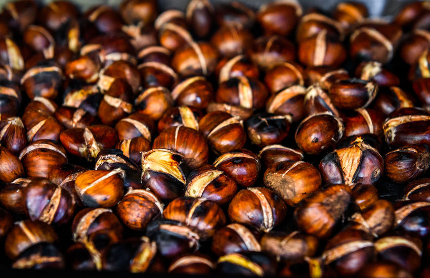Roasting grilled Chestnuts on barbecue with flames, fire and charcoal. Homemade roasted chestnuts are prepared in BBQ grill fireplace. BBQ Chestnuts Homemade Roasting Chestnuts Barbecue Barbecue Grill Charcoal Coal Fire Food Grill Grilled Chestnuts Meat Outdoors Preparing Preparing Chestnuts Preparing Food Roast Roasting