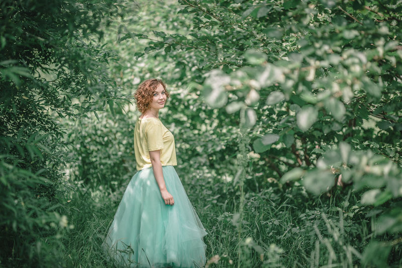 Adult Beautiful Woman Beauty Beauty In Nature Blond Hair Day Freshness Grass Green Color Happiness Nature One Person One Woman Only One Young Woman Only Outdoors Plant Portrait Redhead Smiling Standing Tree Water Women Young Adult Young Women