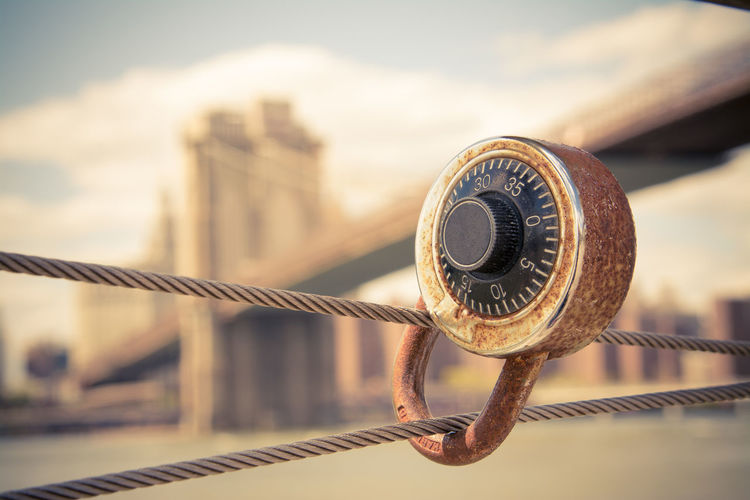 Close-Up Of Lock On Metal Wire