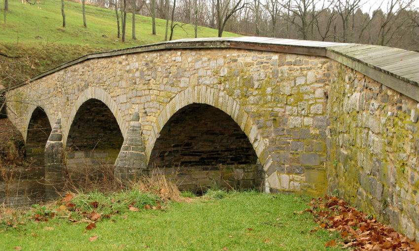 Arch Architecture Built Structure Burnside Bridge Day Grass Ivy Nature No People Outdoors U.S.Civil War