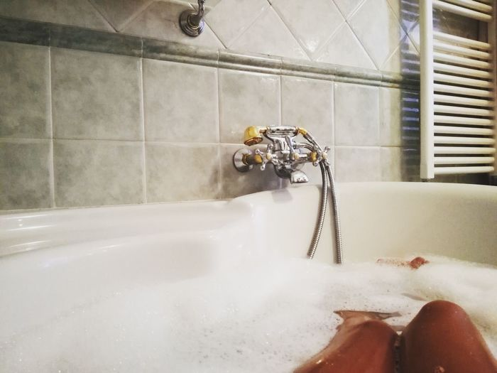 Bathtub Water Domestic Bathroom Domestic Room Taking A Bath Washing Bathroom Faucet Indoors  Hygiene Wet Shower Human Body Part Human Leg Cleaning One Person Low Section Day Close-up One Man Only Girl Relaxing