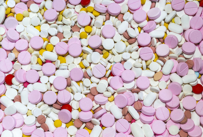 Closeup many different colorful of medicines background Addiction Antibiotic Background Care Chemical Dose Headache Health Hospital Illness Medical Medicine Pain Phamaceutical Phamacy Pill Rescue Sickness Treatment Vitamin