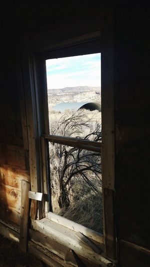 inside the old cowboy cabin Window Indoors  Sky Built Structure Abandoned Cityscape Architecture Looking Through Window Day No People EyeEmNewHere EyeEm Ready   AI Now