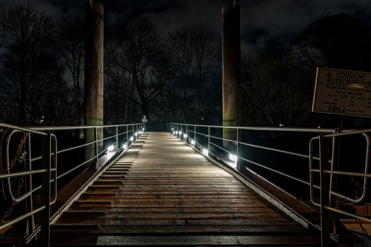 ferry station neuhofe Elbe River Footbridge Hamburg Harbour Köhlbrand Trees Artifical Light Bare Tree Bulb Exposure darkness and light Ferry Station Handrails Neuhofe Night No People Outdoors Pillars Support Railing Sky The Way Forward Tree Wood Planks