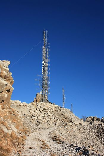 Communication, telecommunication and television antennas, positioned between the mountains