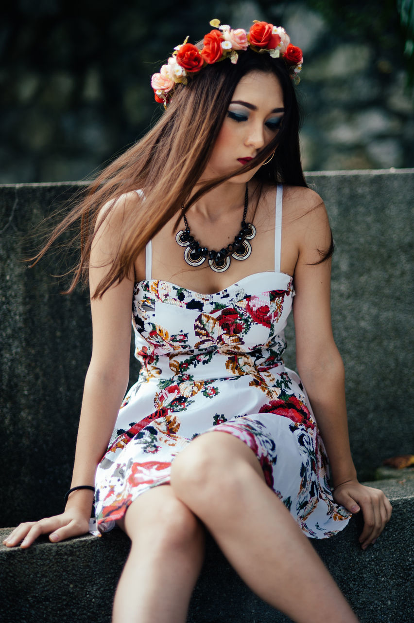 one person, real people, young adult, long hair, young women, casual clothing, beautiful woman, front view, outdoors, lifestyles, day, leisure activity, standing, flower, medium-length hair, full length, nature