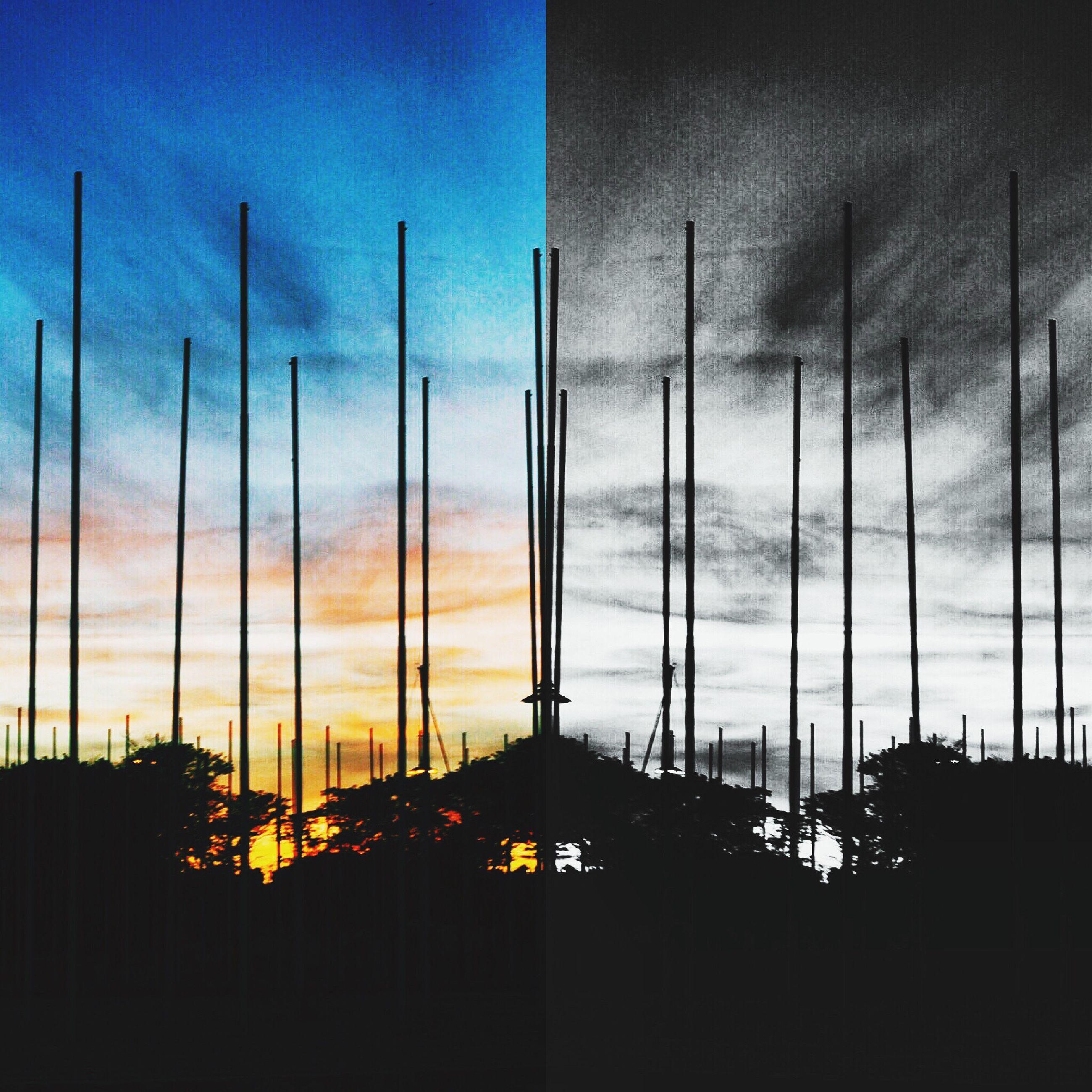 sky, architecture, built structure, sunset, building exterior, cloud - sky, silhouette, low angle view, cloud, city, dusk, transportation, cloudy, no people, outdoors, street light, blue, building, orange color, illuminated