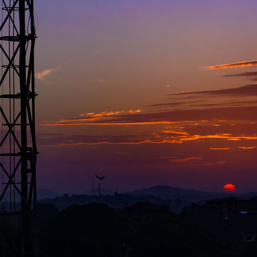 Sunset Silhouette Dramatic Sky Landscape Electricity  Electricity Pylon Fuel And Power Generation Technology Cloud - Sky Connection Social Issues Power Station Antenna - Aerial Tropics Power Supply Outdoors Kampala Infrastructure Cityscape Uganda  Africa Cloud Birds In Flight Cell Tower Business Finance And Industry