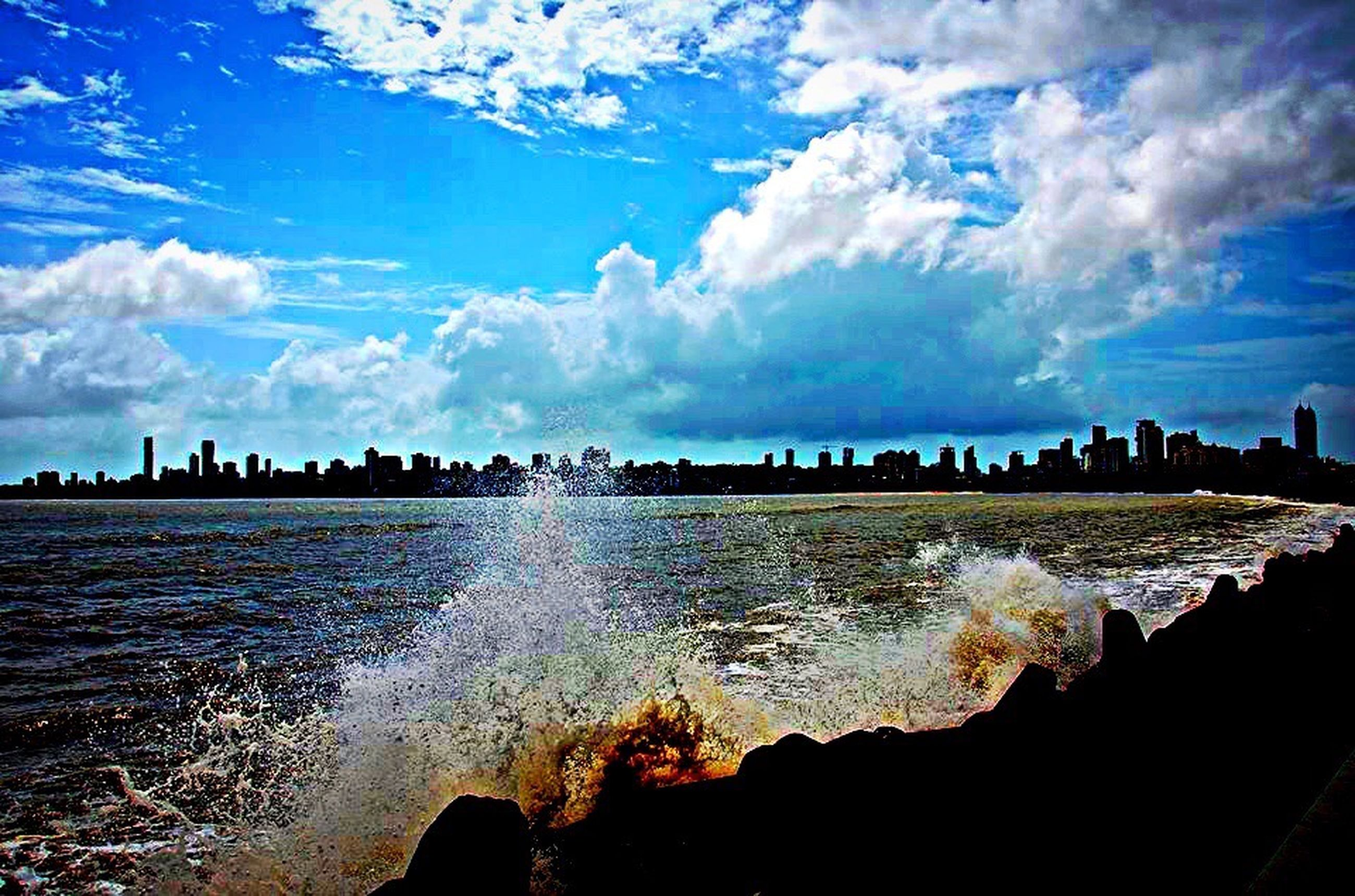 sky, water, motion, nature, beauty in nature, cloud - sky, scenics, landscape, outdoors, large group of people, power in nature, people, day