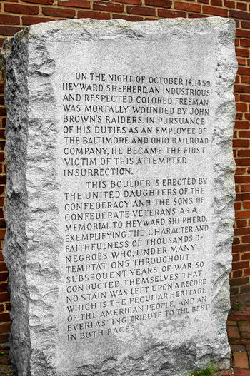 Controversial Faithful Slave Monument At Harpers Ferry National Park: This controversial monument is at the Harper's Ferry National Park in West Virgina. It was erected by the United Daughters of the Confederacy (UDC) and the Sons of Confederate Veterans (SCV) to memorialize Heyward Shepherd, a black man and the first person killed during John Brown's raid on the town in 1859. American Civil War Civil War Faithful Slave Monument Harpers Ferru Harpers Ferry Harpers Ferry National Historical Park Heyward Shepherd Historical Marker Slavery Slavery In America Sons Of Confederate Veterans Tourist Attraction  United Daughters Of The Confederacy Confederate Controversial Monument History John Brown Monument No People Text West Virginia