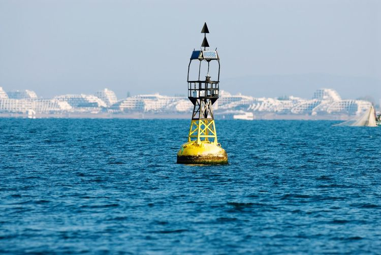 Buoy In Sea Against Clear Sky
