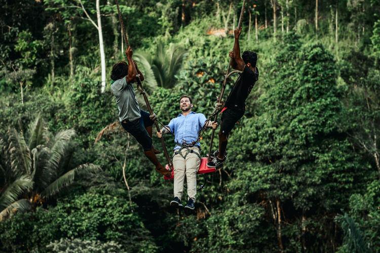 Full length of men in forest