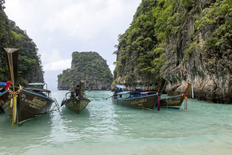 Nautical Vessel Water Transportation Mode Of Transportation Sea Tree Waterfront Nature Beauty In Nature Longtail Boat Day Scenics - Nature Sky Plant Tranquility Moored Land Cloud - Sky Incidental People Outdoors Thailand