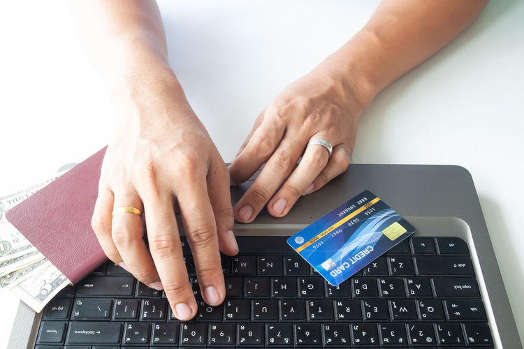 Man hands using laptop computer and credit card. Passport and money Hotel Trip Passport Cart Traveler Plastic Concept Entering E-commerce Cvv Ordering Wireless Tax Male Order Debit Smart Security Man Typing RISK Information Data Lifestyle White Phone Ecommerce Keyboard Notebook Finance Electronic Internet Store Home Buy Technology Commerce Banking Using Purchase Business Pay Computer Shopping Laptop Holding Payment Online  Card Credit