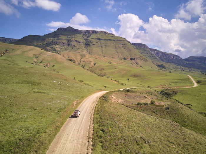 Driving on a dirt road to drakensberg
