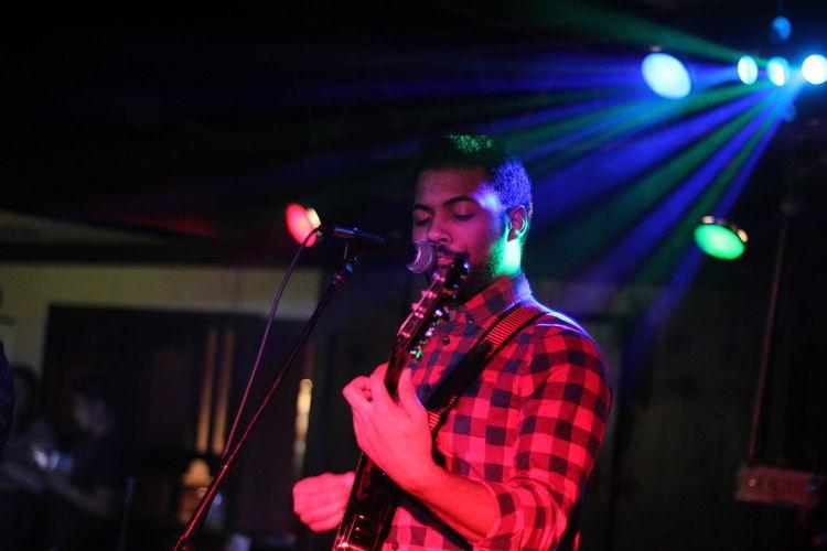 Young man performing at nightclub
