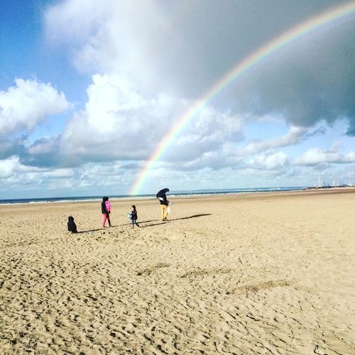 Beach Cloud - Sky Sky Sand Nature Sea Day Beauty In Nature Scenics Real People Water Leisure Activity Outdoors Rainbow Lifestyles Tranquility Togetherness Playing Horizon Over Water Men Familydayout Hangingoutwithfamily