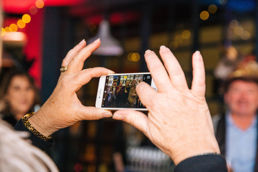 Activity Adult Communication Finger Focus On Foreground Group Of People Hand Holding Human Body Part Human Hand Leisure Activity Lifestyles Men Mobile Phone People Photographing Photography Themes Real People Smart Phone Technology Wireless Technology