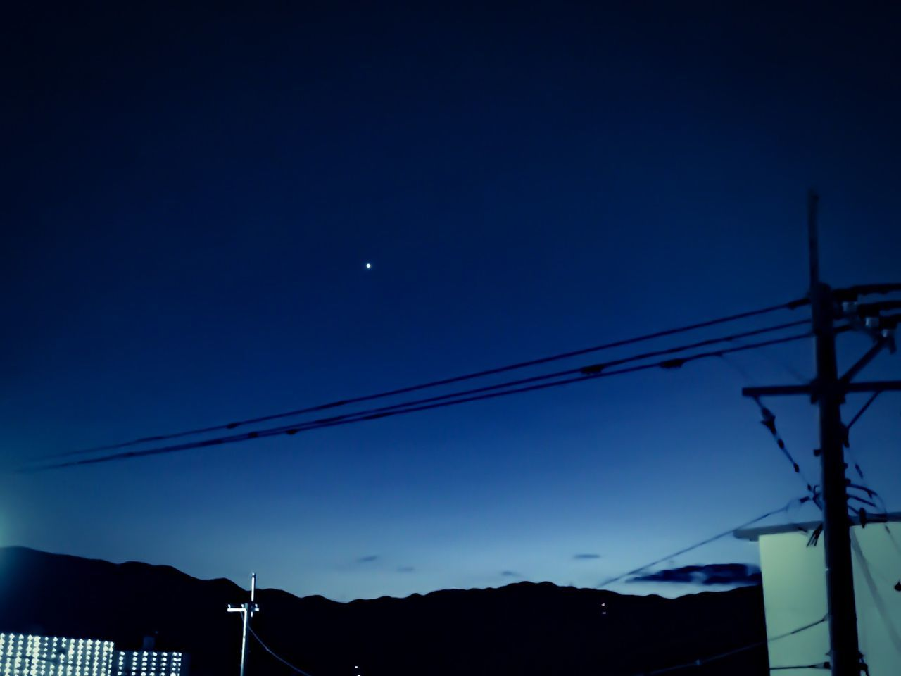 connection, low angle view, cable, moon, electricity, blue, silhouette, power supply, power line, no people, sky, nature, outdoors, clear sky, technology, night, electricity pylon, beauty in nature, astronomy