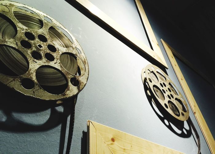 Low Angle View Of Old Film Reels On Wall