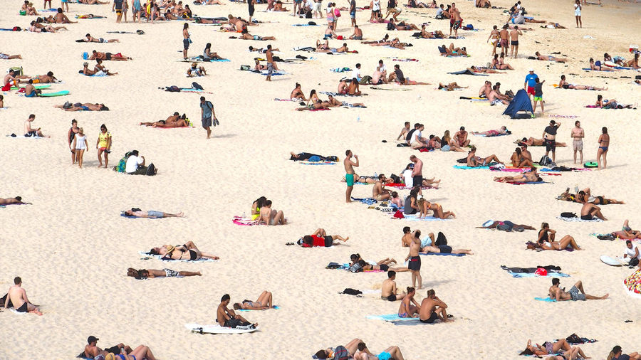 People relaxing at beach
