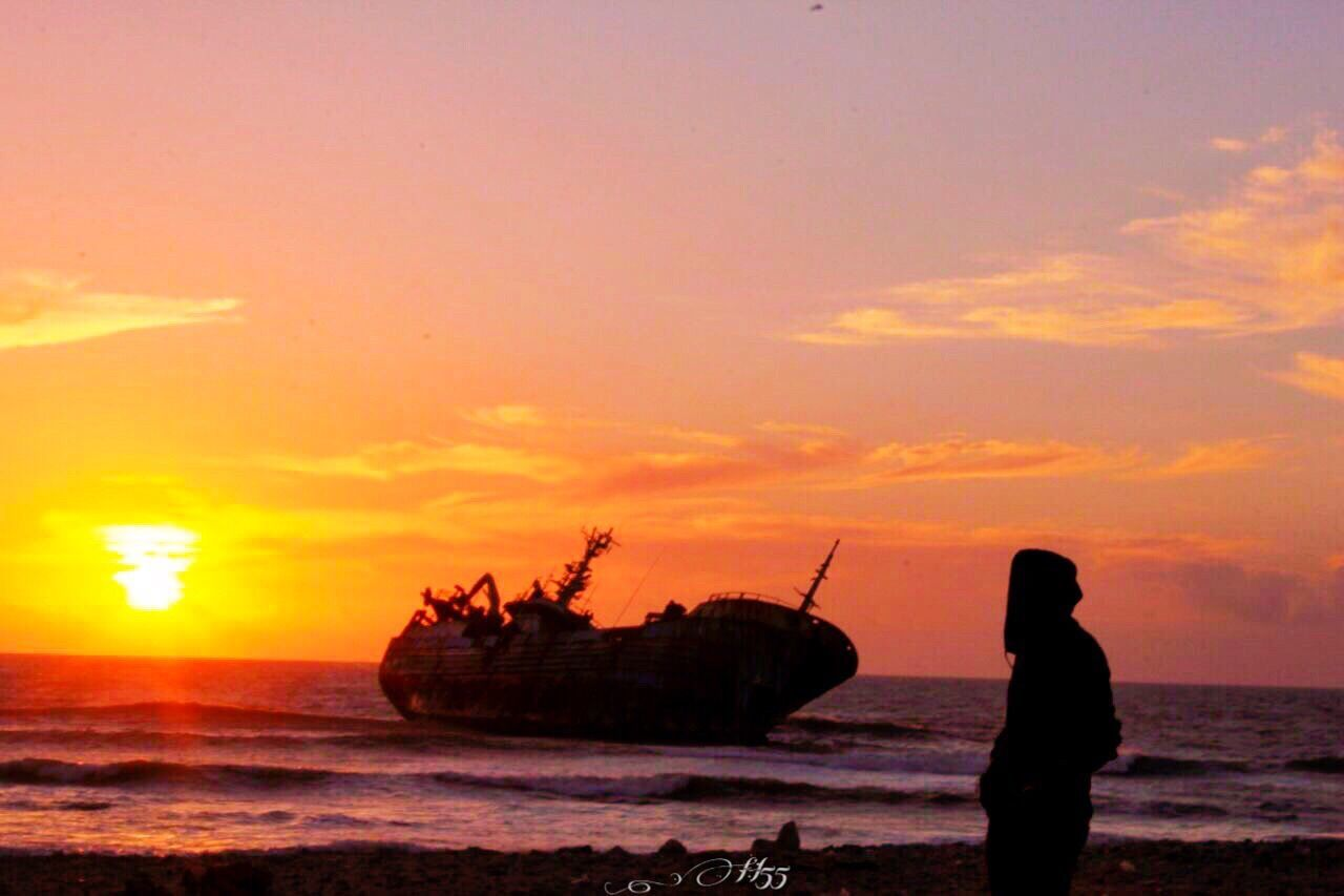 sunset, sea, nautical vessel, beach, water, silhouette, nature, transportation, sky, beauty in nature, one person, outdoors, horizon over water, scenics, wave, real people, day, people
