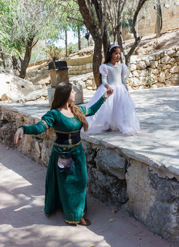 """Jerusalem, Israel, October 03, 2016: Members of the annual festival of """"Knights of Jerusalem"""" dressed as a citizen and princess pose for photographer in Jerusalem, Israel Ancient Annual Attraction Christian Citizen Decorations Dressed Event Famous Festival History Holy Israel Jerusalem Knight  Land Medieval Member Old Performance Performs Photographer Pose Sword Tradition"""