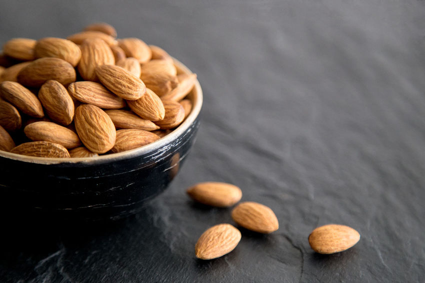 Almonds in a bowl Abundance Almond Bowl Brown Dark Background Dark, Food Food And Drink Freshness Group Of Objects Heap Indoors  Large Group Of Objects Nut - Food Selective Focus Stack Still Life Table