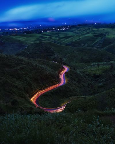 High Angle View Of Light Trails On Mountain Road Against Sky At Night