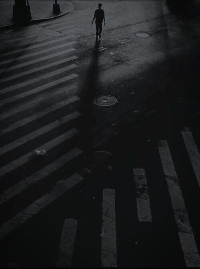 Blackandwhite Streetphotography Street Hello World One Person Road Stripes Nightphotography Night City Shadow Low Section Full Length Ice Rink