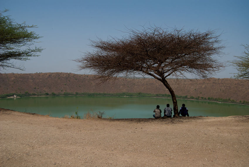 Clear Sky Countryside Crater Lake Incredible India India Tourism Lake Lakeside Lonar Cra Lonar, Maharashtra Tourism Men Nature Person Relaxation Scenics Sitting Togetherness Tranquil Scene Tree Water